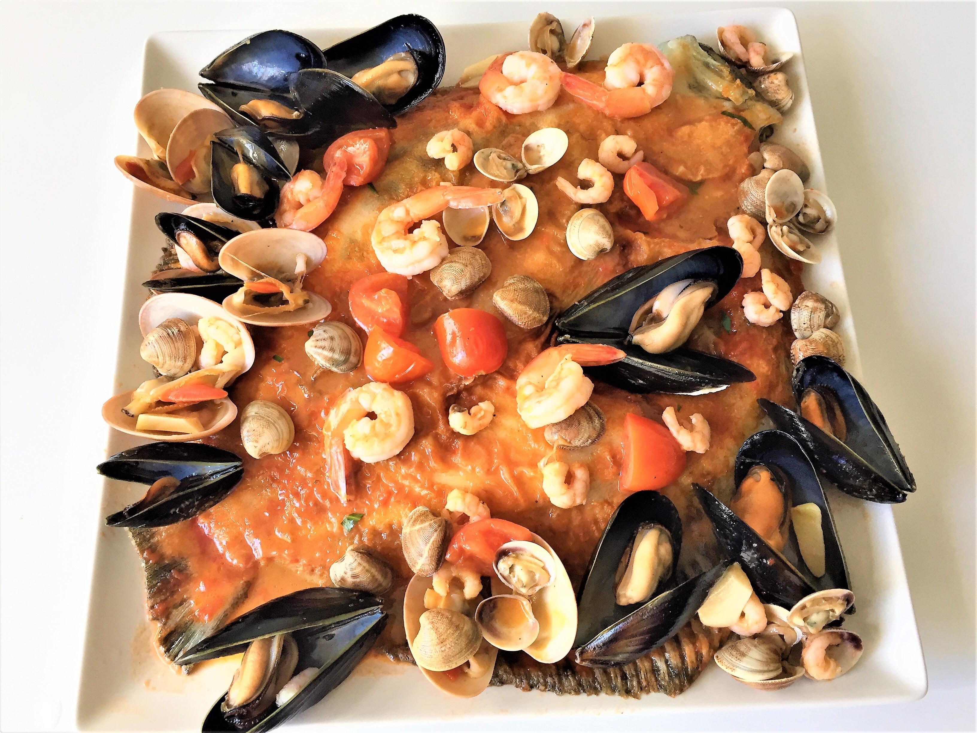 Rombo al forno con frutti di mare
