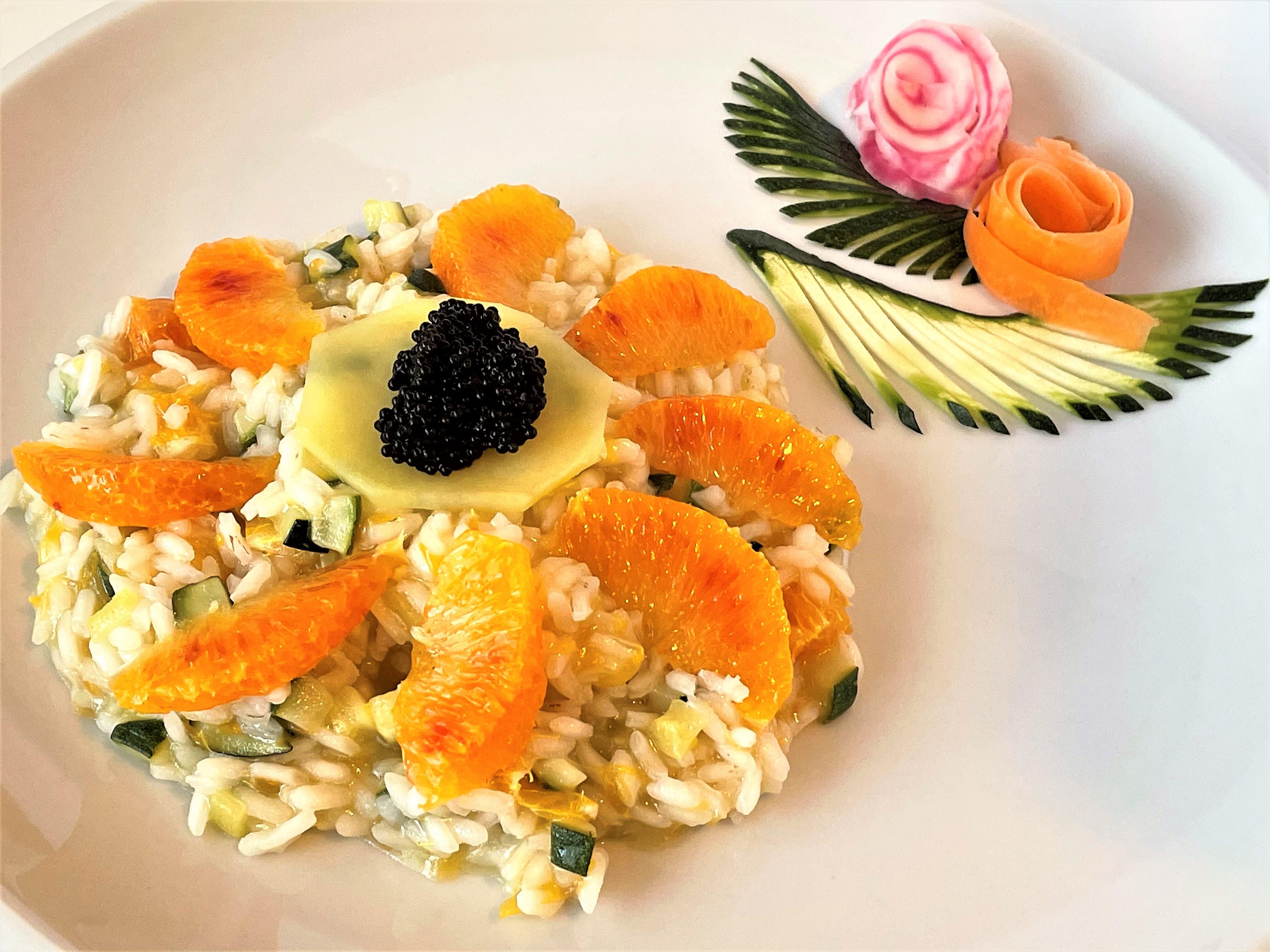 Risotto con zucchine, arancio e caviale